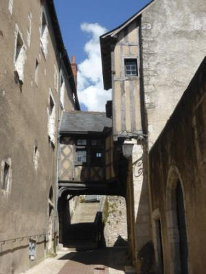 Interesting street in Blois with little bridge house